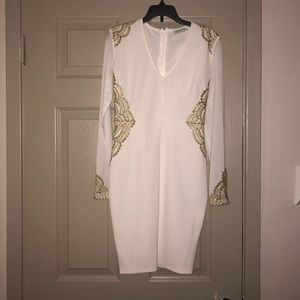 White dress with gold lace on sleeves